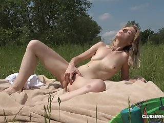 Blonde main feels doughty in the outdoors fingering her cunt